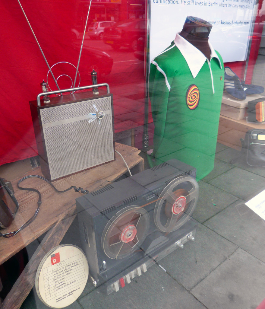Window display including a radio receiver made by Martin Zeichnete's father in the 1950s and a 1970's reel to reel machine used by Zeichnete to record broadcasts from the West.